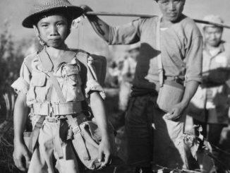 Seorang tentara anak semasa perang Vietnam. (zenith.org)
